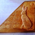 Relief carving by Zoe Gertner of Hare sitting in Ferns