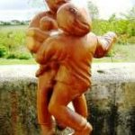 Carving of couple dancing with baby