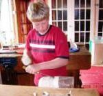 boy carving football trophy