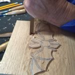 Carving one of the hotel door plaques