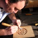 Carving a Celtic pattern during a woodcarving course