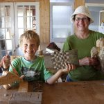 Grandmother and grandson with carvings