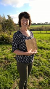 Jenny, a woodcarving course student with her relief carving of Fritillary flowers