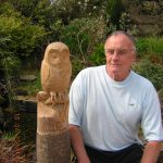 Woodcarving course student with owl woodcarving project
