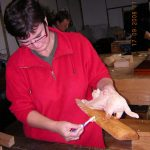 Wax polishing a carving of cat made during a woodcarving course in devon