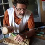 Carving a Cornish engine house in relief during a woodcarving course in devon