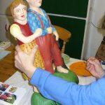 Restoring, repairing repainting two wooden fairground figures