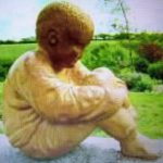 Woodcarving of small boy