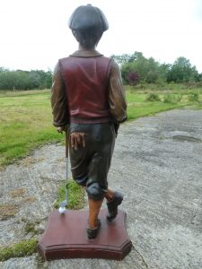 Restored figure of golfer with golf club