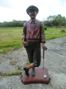 Restored figure of golfer