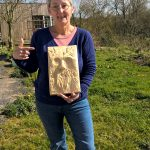 lady with first wood spirit carving