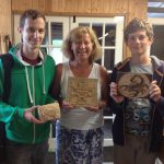 Mother with sons and their first woodcarvings