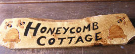 carved by Zoe Gertner a signboard for cottage